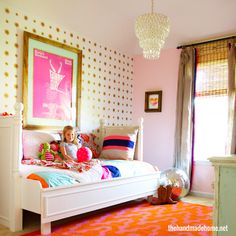 grown-up wallpaper on one wall, pink and orange here and there, vibrant and fun, but sophisticated accents in this big girl room | thehandmadehome.net