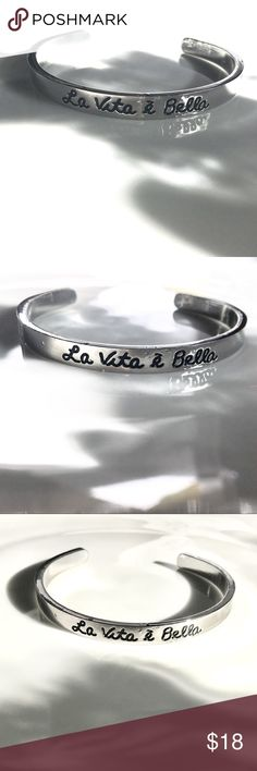 """🇭🇺""""La Vita è Bella"""" Cuff Bracelet """"La Vita è Bella"""" Cuff Bracelet ~ 🇭🇺 """"Life Is Beautiful"""" • Silver Colored • NOT .925 • 2.75"""" across middle • 1.5"""" across opening • Brand new in package • Does not come with price tag/boutique item. NOTE: came with some TINY dings in the metal above lettering - see photos. Beautiful piece & very solid. 🇭🇺 Jewelry Bracelets"""