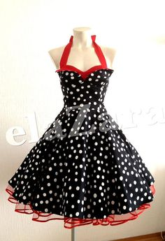 ...Petticoat dress in black with white dots...back is laced with red ribbon, as a corsage    The dress looks great with a 2 layered custom made petticoat