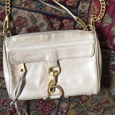 Rebecca Minkoff mini M.A.C. cross body Nude with gold hardware. It has signs of wear on the hardware and leather. Can be worn as a clutch, shoulder bag or cross body with the adjustable strap. Love this bag! Rebecca Minkoff Bags Crossbody Bags