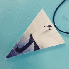 "-SOLD- ""Turn Loose The Swans"" Triangle Woodography pendant with adjustable waxed cotton cord. Check it out NOW in our pop-up store @ Annankatu 19, 00120 Helsinki"
