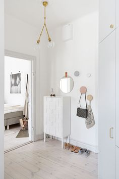 We're loving the timeless palette of beige, grey and nude with brass accents.