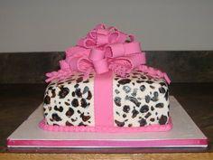 Animal print fondant present cake with big bow.