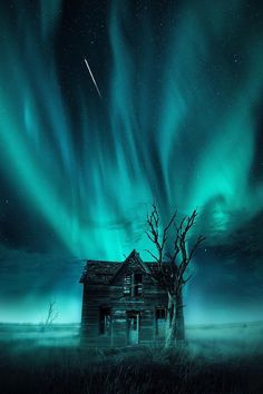 This crazy abandoned house located in Marquette, Kansas, is near the town where I'm from. Jaxson Pohlman, the fantastic artist and photographer who took these photos, is a Kansas boy. He basically layered two photographs to create this beauty - the house/tree + the northern lights.