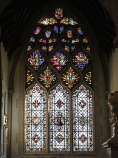 The beautiful stained Becket window in Oxford's Christ Church Cathedral is a gem. The medieval glass in the tracery is clear and deeply coloured, and includes a rare survival - a depiction of the martyrdom of St Thomas of Canterbury. Also seen is St Augustine of Canterbury and St Martin of Tours, as well as heraldic glass, Augustinian canons and Christ in glory with angels.   Below, restored fragments of old glass make a lovely pattern while letting in some light through the plain glass.