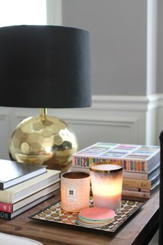 faceted brass lamp. black shade. vignette styling.