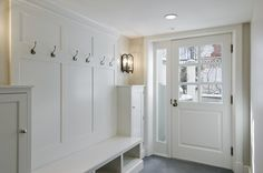The traditional coat closet doesn't work for most of us (except when we've got company – but even then, how many of us toss the coats onto a bed?). I'm a big fan of hooks. Way better than a coat tree – you know they'll get used. From houzz.com, this handsome traditional entry is by Cameo Homes Inc.