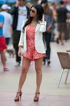 Kourtney Kardashian wearing Yves Saint Laurent Brown Tribute High Heel Leather Sandals and Dolce Vita Cornelia Romper.