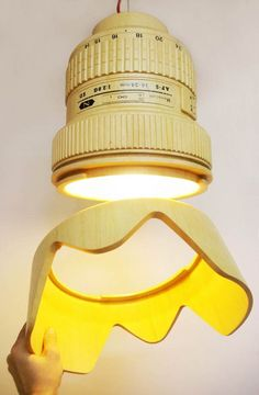 Mónoculo Design Studio modeled this lamp on a Nikkor 14-24mm lens, and it's made out of recycled wood!