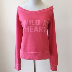 """AE   """"Wild at Heart"""" Sweatshirt Red """"Wild at Heart"""" sweatshirt from American Eagle Outfitters. Has a wide neck and looks great worn off the shoulder! 68% cotton, 32% polyester. Size M. Approx. 23"""" bust, 25"""" long (shoulder to hem). Worn and washed once and in excellent condition. No PP, trades, or holds. Lowball offers ignored. Happy poshing! 🎀 American Eagle Outfitters Sweaters"""