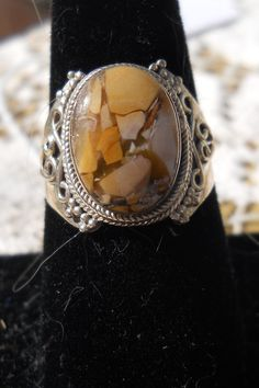 Unusual Matrix Mexican Opal in Sterling Silver    Size 8    $25.00