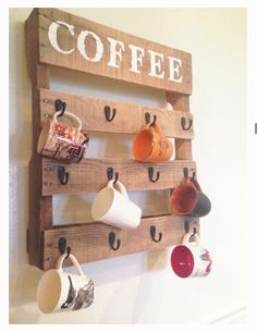 Minus the coffee, this is an adorable mug display made out of cheap materials (palette and hooks)