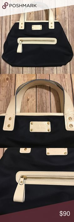 Authentic Kate Spade Nylon handbag Beautiful authentic blue nylon Kate Spade hand bag with leather trim and handle. Exterior has zipper pocket. Interior has one zipper pocket with 2 other pockets which can hold your phone. Fastens on the sides. Width 15.25/ depth 9.5.  In great condition!! kate spade Bags Totes