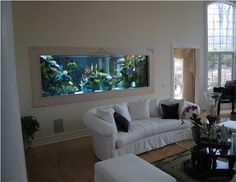 Who needs paintings when you can have an aquarium over your couch? Would add some serious class to just about any livingroom.