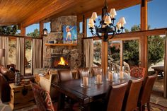 Love the windows looking out in this rustic living room