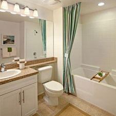 Gorgeous green bathroom decor | Irvine Company Apartment Communities - Cypress Village Apartments, Irvine, CA
