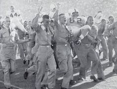 Aggie corps memebers carry the team off the field (including John David Crow (#44)) after a big win during Texas A & M's '56 season