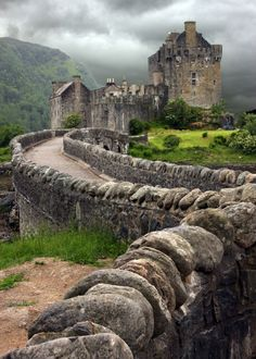 "Eilean Donan Castle  (Eilean Donan is a small island in Loch Duich in the western Highlands of Scotland. It is connected to the mainland by a footbridge and lies about half a mile from the village of Dornie. Eilean Donan simply means ""island of Donnán"""