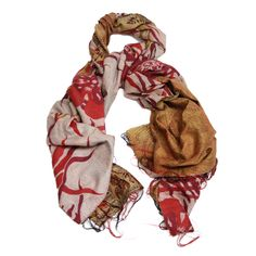 The eye-catching Silk Kantha Scarf features ornate patterns and the characteristic running stitch, giving it an exuberant look and striking details.  With vintage silk and hand-done stitching, each Kantha has a unique touch and is one-of-a-kind.