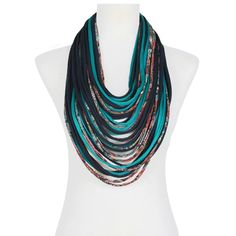 Pair this scarf-lace with a simple black blazer and chandelier earrings for a standout look.