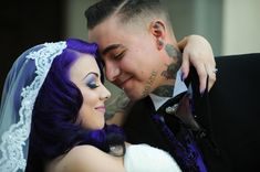 A creepy and elegant gothic wedding - Halloween-themed reception which meshed with their gothic looks perfectly… think dark candelabras, a spooky candy buffet, purple lighting, and fog. Their sweetheart table had his-and-hers leather thrones, blood red goblets, and a even a crow!