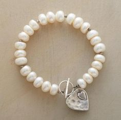 """A heart-within-a-heart reaches out from the sterling silver toggle clasp on our bracelet of cultured freshwater pearls. A handcrafted exclusive. Approx. 7-1/4""""L."""