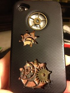 Wanted a steampunk iPhone case but I needed a little more protection than some of the standard cases give. I used the Otter box case I had. I took off the rubber outer case, punched cogs in it with my Sizzix. I then cut a sheet of copper to fit the back of the inner case. I glued cogs from the Tim Holtz collection under where the outer rubber case was punched.