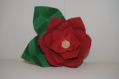 Christmas Time!  Adding this beautiful flower to your presents will not only impress the person getting the gift but add an elegant touch as well! Who wants to keep using the same old stick on bows that never stay? Use this beautiful flower instead! A gift within itself! #christmas #presenttopper #gift #bow #poinsettia  #paperflower #gifts #topper #tofromtag #impressed #chirstmastime   https://www.etsy.com/listing/255632256/paper-flower?ref=shop_home_active_10