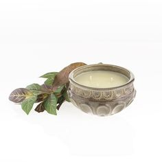 Great stoneware container in a neutral color with a rich, creamy tropical vanilla that is accentuated with sugar notes of mango.