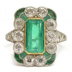 LADIES ART DECO EMERALD & DIAMOND PLATINUM RING - Ladies Art Deco gemset platinum estate ring having 18kt gold bezel, the rectangular frame set with: (1) central emerald, approx 1.42 cts total weight; (12) caliber-cut emerald; (18) old European cut diamonds, approx 1.43 cts total weight : Lot 854