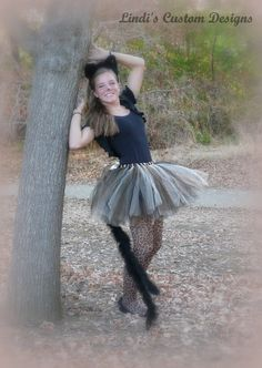 Ooooh la la~~ This listing is for the pictured boa tail tulle tutu in girls through adult sizes up to a 34 waist measurement. Tutu is made