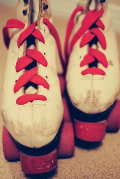 Red laced roller skates