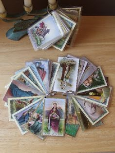 Punch a hole in holy cards and put them on a key ring. A great solution for what to do with the many holy cards Catholic families amass!