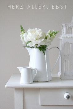 Enamel jugs and white flowers