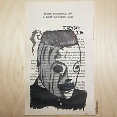 """Book page painting of Corey Taylor from Slipknot's """"All Hope Is Gone"""" album. Painted onto a page from the Satanic Bible!  mrcrypt.bigcartel.com"""