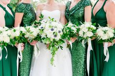 Bouquets featuring white/cream roses, white anemones, Queen Anne's Lace, and greenery | Gold, Black, White + Green Lowndes Grove Plantation Wedding by Charleston wedding photographer Dana Cubbage Weddings