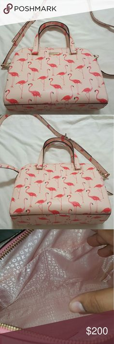 Kate Spade Small Felix Flamingo Print New never used Kate Spade Small Felix handbag. Has two hand straps. Detachable and adjustable shoulder strap. Flamingo printed. Beautiful light pink inside. Took out stuffing to show inside.  Light pink with bright printed flamingoes.pink inside with gold hardware. From Newberry lane printed flamingo range. Perfect sized for day to day or work bag. Fits a full size wallet, phone, small makeup bag, tablet and many other items. Ask about bundles on adding…