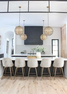 Black shiplap statement hood in contemporary kitchen