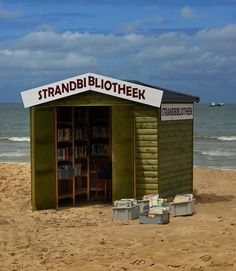 Amanda Patterson (Beach Bookshop in Belgium) if only it were a library -every beach should have one