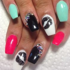 ..colorful nails with kiss decal..