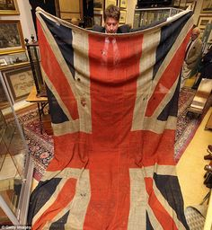 The only surviving Union Jack flag from the Battle of Trafalgar, sold at auction today. The huge flag, that is littered with holes from shot damage and still has a whiff of gunpowder, flew from the jackstaff of HMS Spartiate at the historic battle 204 years ago.  After the victory over Napoleon's French army, the crew lowered the flag and presented it to Lieutenant James Clephan for his outstanding performance.
