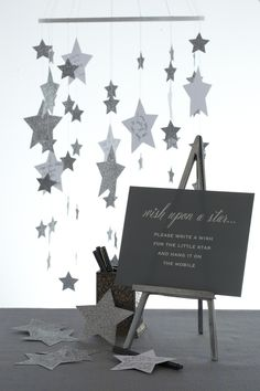 I just adore the idea of writing words of motherly advice on a star to add to this star mobile. Perfection! #babyshower @HUGGIES Baby Shower Planner