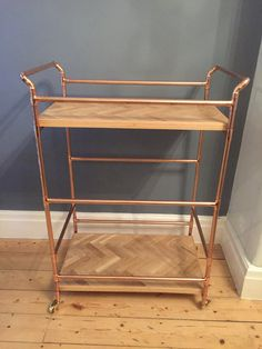 Add a luxurious industrial feel to your living space with this stunning reclaimed wood and copper pipe drinks trolley.  Approximate dimensions; Length 60cm (24.5) Width 35cm (13.5) Height 85cm (33.5)  The 2 levels of this table are made from reclaimed oak inlayed in a herringbone design. It has been carefully sanded to a nice smooth finish and then varnished to give a hardwearing and durable finish whilst retaining its aged character and texture. All edges are gently rounded off. The tables…