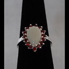 New Garnet & Opal Ring in Sterling Silver 15 Genuine Round Red Garnets beautifully surround a 2.15 carat Pear Opal, ring in 925 Sterling Silver.   Certainly to be an eye catcher wherever you go.  A true gem of a ring!  New never worn. Jewelry Rings