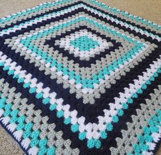 Navy, gray, turquoise and white granny square baby blanket. This is a very special handmade crochet baby blanket.  This baby afghan will make a wonderful baby shower gift.  This blanket would make a lovely addition to your baby nursery decor. Perfect also, for travel, strollers, prams, cribs, tummy time and photo props