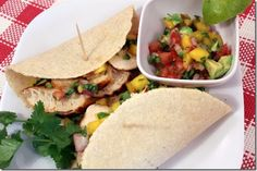 For a truly tropical experience, try these Grilled Chicken Tacos with Mango-Avocado Salsa