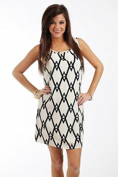 """Tribal Tank Dress, Ivory/Blk $41.00  OMG, this piece is a wardrobe staple! The classic colors can be worn year round, and this piece has an expensive feel to it, fully lined and with a silky material. The tribal inspired patterns are right on trend, and we love the big keyhole on the back with a tie closure at the neck.   Fits true to size. Miranda is wearing a small.   From shoulder to hem:  Small - 33""""  Medium - 34""""  Large - 35"""""""