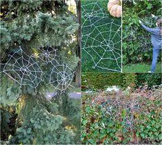 Gartenbäume mit Spinnennetzen dekorieren
