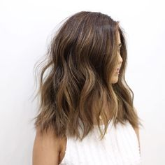Hair goals! Love this bebs loose curls! Also we are loving the shade of brunette! So pretty!