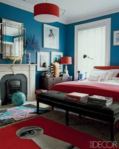 Estée Lauder executive John Demsey topped the leopard-print carpeting in the master bedroom of his Manhattan townhouse with boldly colored rugs by Roubini. The bench is by Antony Todd, the bedding is by Pratesi, the coverlet is by Hermès, and the walls are painted in Caribbean Blue Water by Benjamin Moore.   - ELLEDecor.com